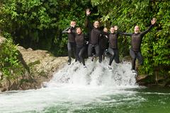Stock Photo of Group Of Six People Three Pairs Jumping In The Same Time Into A Waterfall