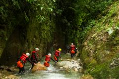 Stock Photo of Group Of People Crawling Into Canyons Of Llanganates Nation Park In Ecuador