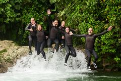 Group Of Six People Three Pairs Jumping In The Same Time Into A Waterfall Stock Photos
