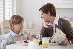 Mother and child at breakfast Stock Photos