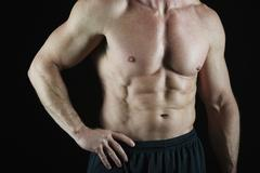 Shirtless muscular man - stock photo
