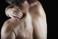 Man with shoulder pain - stock photo