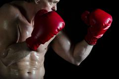 Boxer wearing red boxing gloves - stock photo
