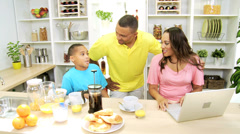 Stock Video Footage of Busy African American Family Kitchen Mom Wireless Laptop