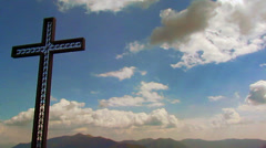 cross in mountain - time laps clouds - stock footage