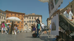 Selling art in Piazza Navona, Rome 5 (slomo dolly) Stock Footage