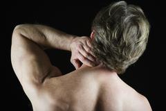 Man with neck pain Stock Photos