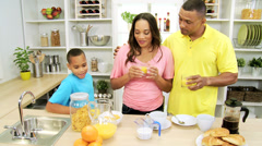 Ethnic Parents Young Son Enjoying Breakfast Home Together - stock footage