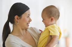 Mother holding son (6-11 months) Stock Photos
