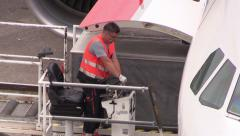 Unloading cargo from airplane - stock footage