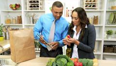 Young Ethnic Couple Tablet Healthy Food Shopping Stock Footage