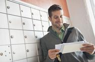 Stock Photo of Man looking at correspondence