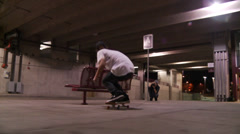 Skateboarder Lands Line of Trucks Stock Footage