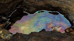 OIL SPILL DISASTER WATER REFRACTION REFLECTION Stock Footage