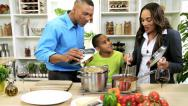 Stock Video Footage of Caring Ethnic Parents Providing Son Healthy Dinner