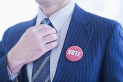 Vote pin on man's lapel Stock Photos