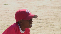 Boy poised to catch  baseball. Stock Footage