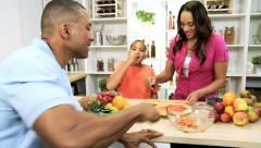 Loving Ethnic Family Kitchen Counter Slicing Fruit Stock Footage