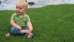 Baby boy by the lake Stock Footage