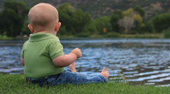 Baby boy at the pond. - stock footage