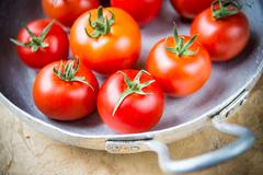 Rustic tomatoes in the skillet Stock Photos