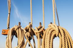 Coiled ropes on yacht deck Stock Photos