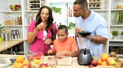 African American Parents Watching Son Prepare Fruit Kitchen Stock Footage