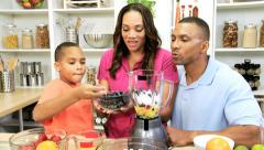 African American Family Blender Fresh Fruit Drink - stock footage