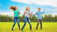 Teens dancing in a meadow Stock Footage