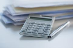 Studio Shot of calculator, pen and paper material Stock Photos