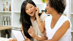 Female Friends Music Downloads Tablet Kitchen Close Up - stock footage