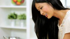 Smiling Asian Chinese Girl Tablet Social Networking Stock Footage