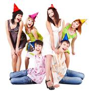 Group of people in party hat celebrate birthday. Stock Photos