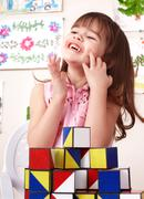 child playing  block in play room. - stock photo
