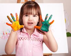 Kid making handprints with paint. Stock Photos