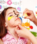 Stock Photo of child with face painting.