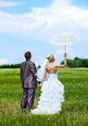 bride and groom summer outdoor. - stock photo