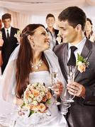 wedding couple drinking champagne - stock photo