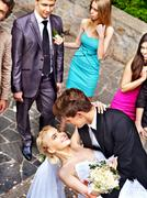 Groom kissing bride . Stock Photos