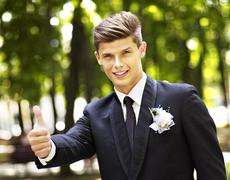 Stock Photo of man groom in park .