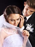 groom embracing bride . - stock photo