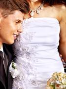 Groom embracing bride . Stock Photos