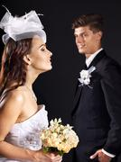couple wearing wedding dress and costume. - stock photo