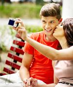 Couple   with camera take pictures Stock Photos