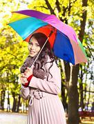 Stock Photo of woman wearing autumn coat outdoor.