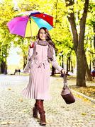 woman wearing autumn coat outdoor. - stock photo