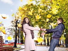 couple on date autumn outdoor. - stock photo