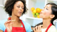 Young Girlfriends Tasting Baking Home Kitchen Close Up - stock footage