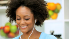 African American Girl Listening Music Working Kitchen Stock Footage