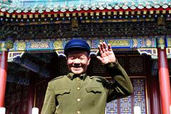 chinese man wearing mao tzetung suite and hat in beijing china - stock photo
